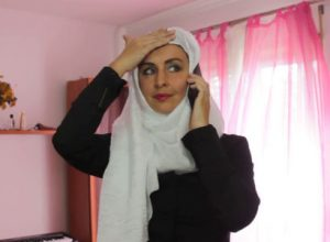 Arabic woman on phone chatting friend